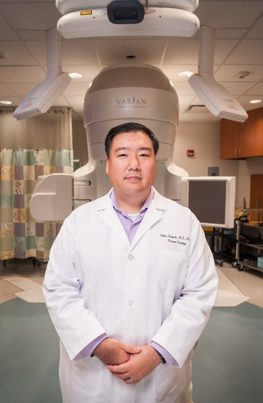 Cullen Taniguchi with the TrueBeam in Radiation Oncology